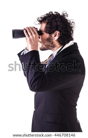 a young and handsome businessman with binoculars isolated over a white background - stock photo