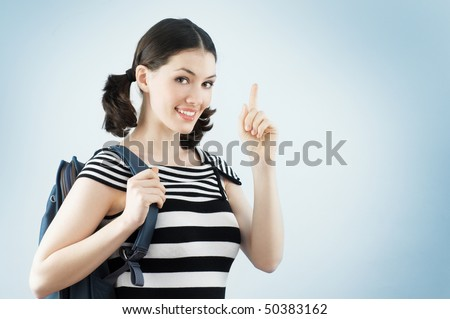 A young and happy female college student - stock photo