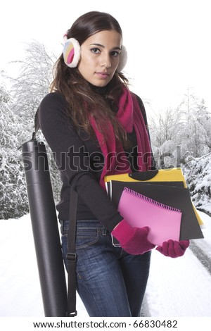 a young and student girl holding her books to go to school - stock photo