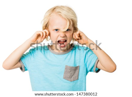 A young angry boy screaming and blocking his ears. Isolated on white. - stock photo