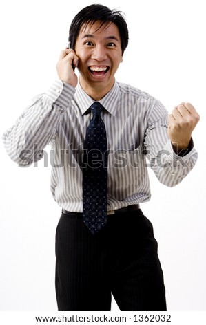 A young asian businessman smiles as he makes a deal - stock photo