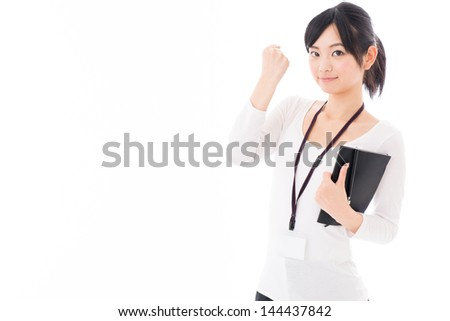 a young asian businesswoman cheering on white background - stock photo