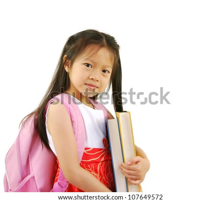 A young asian girl prepares for school with a new backpack - stock photo