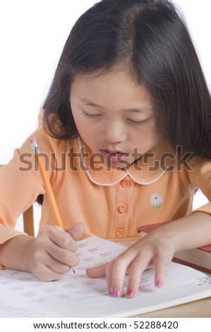 A young asian girl ready for school - stock photo