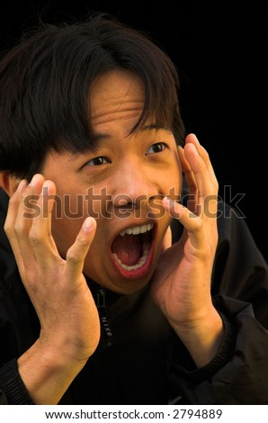 A young Asian man with a shocked expression on his face.