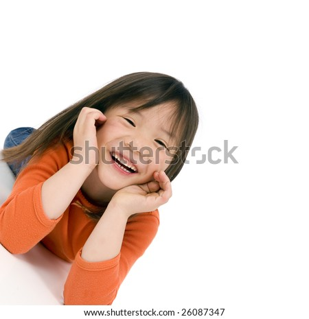 a young asian school girl being silly - stock photo