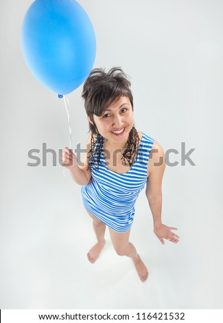 A young Asian woman with balloon