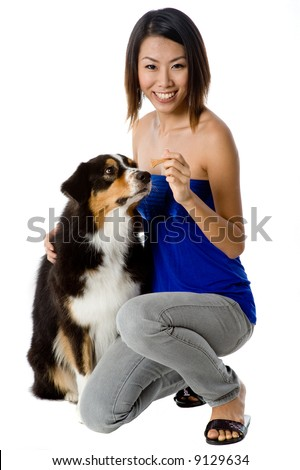 A young Asian woman with her dog on white background
