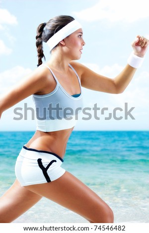 A young athlete running by lake - stock photo