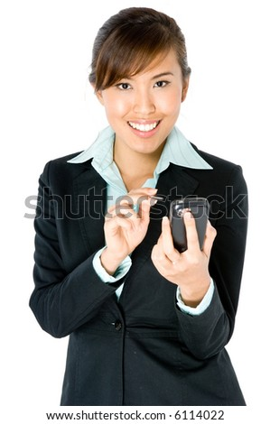 A young attractive Asian businesswoman with handheld computer on white background