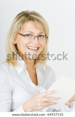 a young attractive blonde with glasses and a book