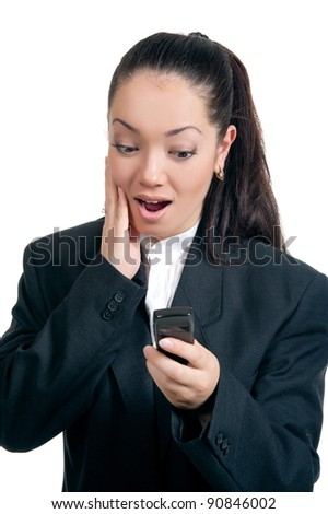 A young attractive brunette businesswoman posing with the phone, isolated on a white background.