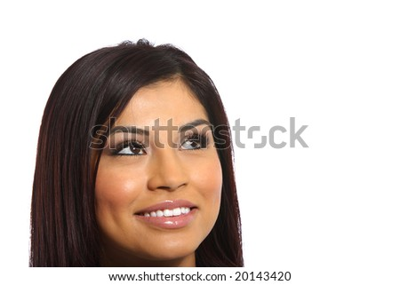 A young attractive business woman in the studio looking up - stock photo