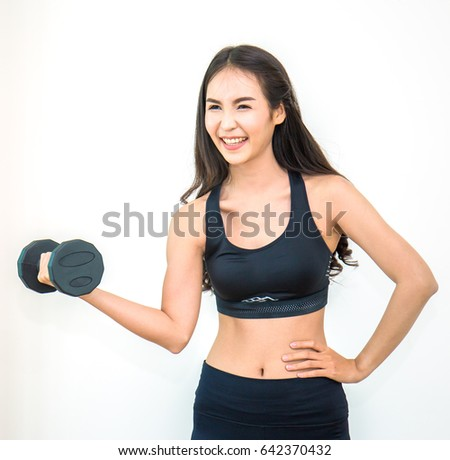 A young attractive woman exercising with weights isolated on white background