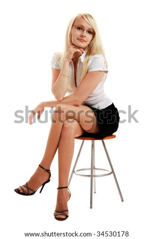 a young attractive woman sitting on stool, isolated on white background - stock photo
