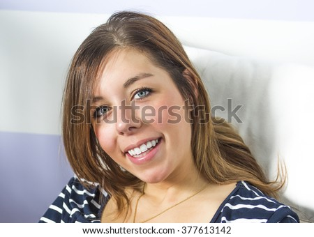 A Young attractive woman smiles brightly  - stock photo
