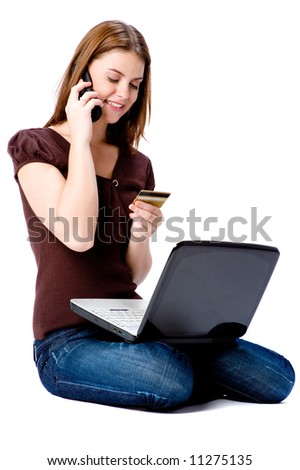 A young attractive woman with laptop and credit card making online purchase