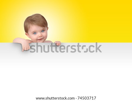 A young baby is holding a white isolated sign. Add your message in the blank copyspace. - stock photo