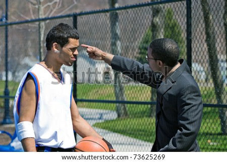 A young basketball player gets yelled at by his coach. - stock photo