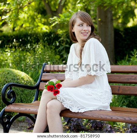 A young beautiful lady is waiting for her boy friend - stock photo