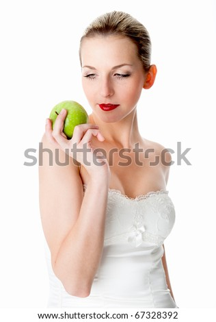 A young, beautiful woman eats a green apple