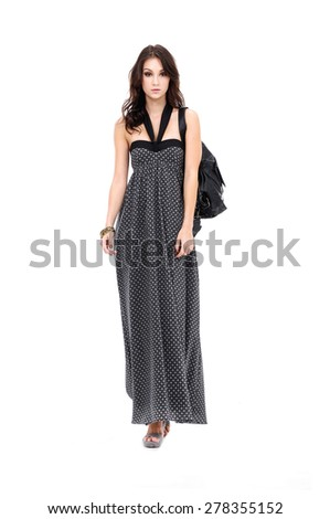 a young beauty in long black dress with bag   - stock photo