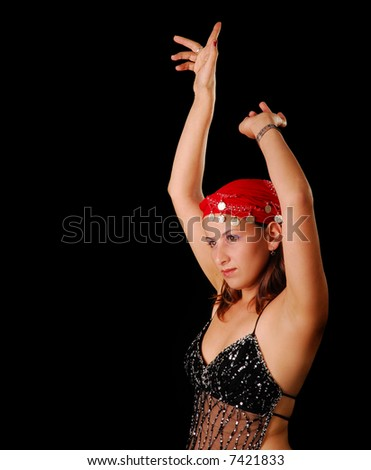 A young belly dancer in traditional dance outfit - stock photo