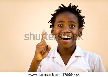 A young black boy has a eureka moment. - stock photo