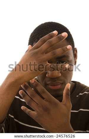 A young black man hiding his face with the hands - stock photo