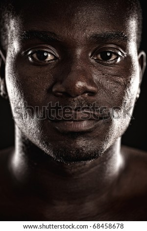 A young black man staring at you
