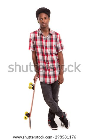 A young black skater posing in studio