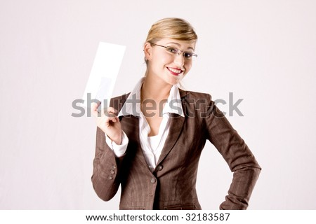 a young blond business woman with an envelope in her hand