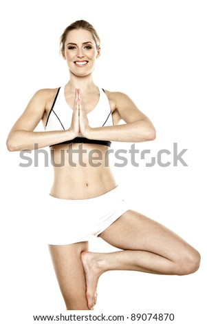 A young blond woman doing yoga exercise. Yoga.