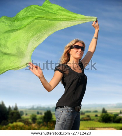 A young blond woman with a green scarf - stock photo