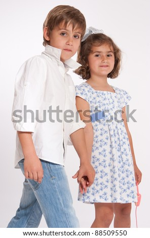 A young boy and a little girl holding hands - stock photo