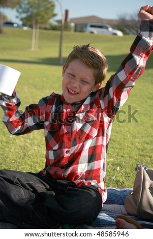 a young boy at a picnic - stock photo
