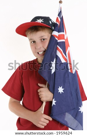 A young boy casually holds an Australian flag