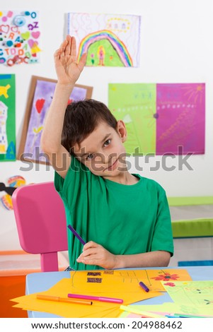 A young boy comes to the response to lessons - stock photo