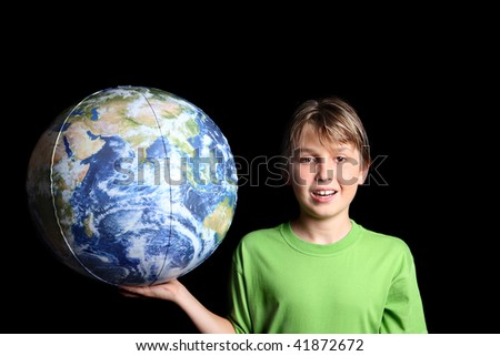 A young boy holding the earth world ball in his hand against a black background.  Images from Nasa.