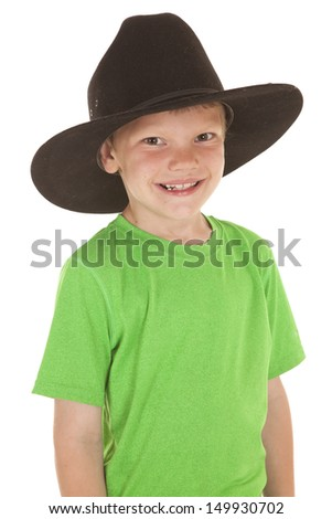 A young boy in a green shirt with a smile. - stock photo