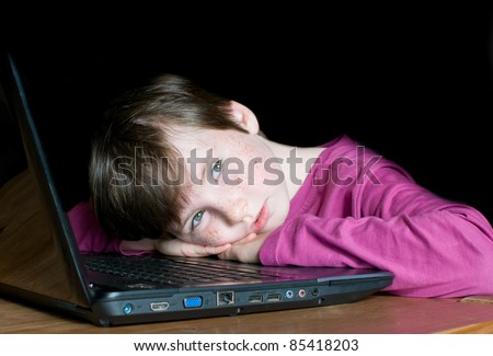 a young boy is dreaming on laptop