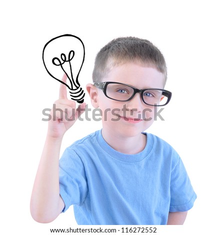 A young boy is holding a drawing of a light bulb and wearing glasses against a white isolated background and looks smart with an idea. - stock photo