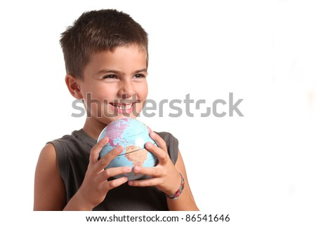 A young boy is holding the planet Earth in his hands - stock photo