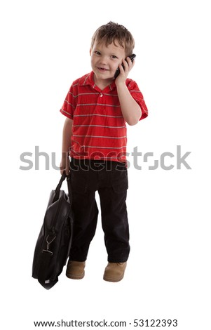 A young boy is smiling and talking on the phone - stock photo