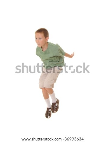 A Young boy jumping isolated over white