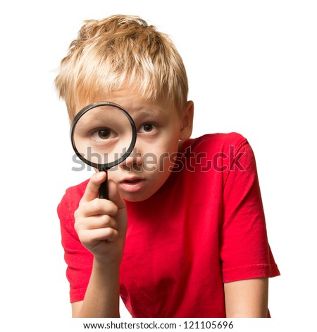 A Young Boy looking at You through the Magnifier Glass - stock photo