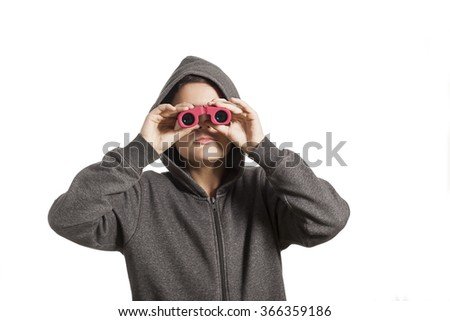 A young boy looking through binoculars  - stock photo