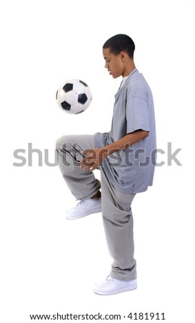 A young boy playing with a soccer ball. - stock photo