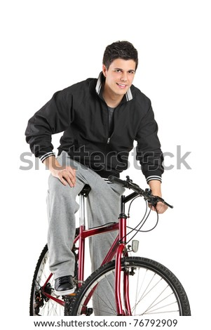 A young boy posing on a bike isolated on white background - stock photo