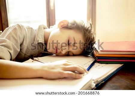 A young boy stressed on homework - stock photo
